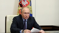 Russian President Vladimir Putin attends the launching ceremony of the Gazprom's Amur Gas Processing Plant, via a video…