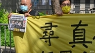 Supporters of two executives from Hong Kong's pro-democracy Apple Daily newspaper, chief editor Ryan Law and CEO Cheung Kim…