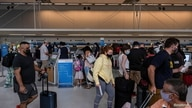 Travellers make their way to the gates at Detroit Metropolitan Wayne County Airport, as domestic travel picks up across the…