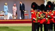 U.S. President Joe Biden, first lady Jill Biden and Britain's Queen Elizabeth stand in front of members of the Royal Guard, at…