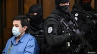Slovak businessman Marian Kocner is escorted by security officers for a public hearing at the Slovak Supreme Court as he and…