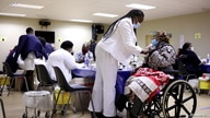A woman receives a dose of a coronavirus disease (COVID-19) vaccine, as South Africa rolls out the coronavirus disease (COVID-19) vaccination to the elderly at the Munsieville Care for the Aged Centre outside Johannesburg, South Africa May 17, 2021.