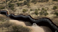 FILE - This March 2, 2019 photo shows a Customs and Border Control agent patrols on the US side of a razor-wire-covered border…