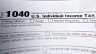 FILE - This Wednesday, Feb. 13, 2019 file photo shows part of a 1040 federal tax form printed from the Internal Revenue Service…