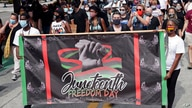 FILE - In this June 19, 2020, file photo, demonstrators march through downtown Orlando, Fla., during a Juneteenth event…