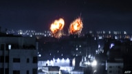 Explosions light-up the night sky in Gaza City as Israeli forces shell the Palestinian enclave.