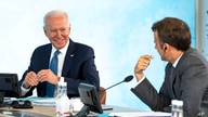 President Joe Biden talks with French President Emmanuel Macron during the final session of the G-7 summit in Carbis Bay, England, June 13, 2021.
