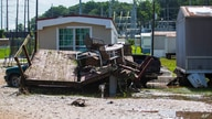 Debris is seen from flooding caused by Tropical Depression Claudette, in Northport, Alabama, June 20, 2021.