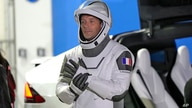 FILE - European Space Agency astronaut Thomas Pesquet of France talks to family and friends before a launch attempt at the Kennedy Space Center in Cape Canaveral, Florida, April 23, 2021.