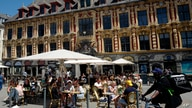 People enjoy a meal in a terrace restaurant during the nationwide reopening of restaurants, in Lille, northern France, June 9, 2021.