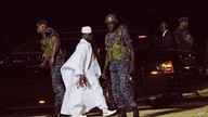 FILE - Gambia's former leader Yahya Jammeh, in white, is seen at Banjul airport, Gambia, Jan. 21, 2017.