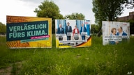 FILE - Election campaign posters from Germany's Green party and Christian Democratic Union party stand near a road in the federal state Saxony-Anhalt's capital Magdeburg, Germany, June 2, 2021.
