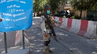 FILE - An Afghan security officer stands guard at the Green Zone, which is home to a number of foreign embassies, in Kabul, Afghanistan, May 25, 2021.