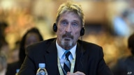 FILE - Antivirus software entrepreneur John McAfee listens during an internet security conference in Beijing, China, Aug. 16, 2016.