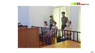 FILE - A screen grab from Myawaddy TV video shows deposed Myanmar leader Aung San Suu Kyi (center-left) and others before a special court, in Naypyitaw, Myanmar, May 24, 2021.