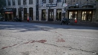 Blood stains remain on 6th Street after an early morning shooting, June 12, 2021 in downtown Austin, Texas.