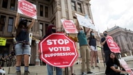 FILE - Voting rights activists gather during a protest against Texas legislators who are advancing a slew of new voting restrictions, in Austin, Texas, May 8, 2021.