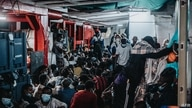 This handout photograph released by SOS Mediterranee on July 6, 2021, shows some of the 369 migrants who were rescued from a…