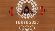 An overview shows Philippines' Hidilyn Diaz competing in the women's 55kg weightlifting competition during the Tokyo 2020…