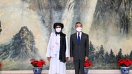 This photo taken on July 28, 2021, and released by China's Xinhua News Agency shows Chinese State Councilor and Foreign…