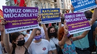"""Demonstrators hold a placard which reads as """"to Struggle Shoulder to Shoulder"""" on July, 31 2021 in Istanbul, as they take part…"""