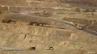 Trucks are seen at a copper mine in Sarlingyi township March 14, 2013. People whose land was seized to allow the expansion of…