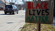 FILE PHOTO: A Black Lives Matter sign is seen near the corner of Emerson Street and Dodge Avenue in Evanston, Illinois, U.S.,…
