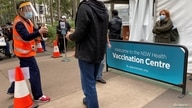 People wait outside a coronavirus disease (COVID-19) vaccination centre at Sydney Olympic Park in Sydney, Australia, July 14, 2021.