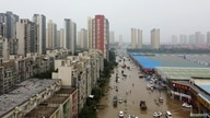 An aerial view shoes a flooded road following heavy rainfall in Zhengzhou, Henan province, China July 23, 2021. Picture taken…