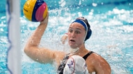 July 24, 2021; Tokyo, Japan; Team United States centre forward Aria Fischer (9) shoots the ball against Team Japan driver Yumi…