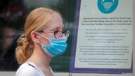 A woman wears a mask against the coronavirus disease (COVID-19), following the CDC recommendation that fully vaccinated…