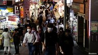 People wearing protective masks, amid the coronavirus disease (COVID-19) outbreak, make their way at a shopping district in Tokyo, Japan, July 28, 2021.