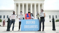 FILE - Deferred Action for Childhood Arrivals (DACA) demonstrators stand outside the U.S. Supreme Court in Washington, June 15, 2020.