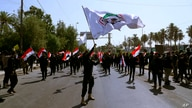 Iran-backed militia fighters march in central Baghdad, Iraq, Tuesday, June 29, 2021.  Iraqi Shiite militias are showing a…