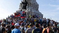 Anti-government protesters gather at the Maximo Gomez monument in Havana, Cuba, Sunday, July 11, 2021. Hundreds of…