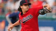 Cleveland Indians starting pitcher Cal Quantrill delivers in the first inning of a baseball game against the Tampa Bay Rays,…