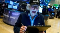 """Trader Peter Tuchman wears a """"Dow $35,000"""" hat to mark the Dow Jones Industrial Average closing at 35,061.55, on the floor of…"""