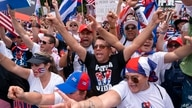 With the White House in the background, hundreds of people, many of Cuban descent, protest the Cuban government, Monday, July…