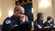 U.S. Capitol Police Sgt. Aquilino Gonell, from left, Washington Metropolitan Police Department officer Michael Fanone,…