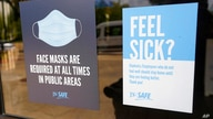 Face mask requirements are posted at the various entrances at the Rose E. McCoy Auditorium where COVID-19 vaccinations are…