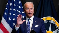 President Joe Biden finishes leaves after speaking during a visits to the Office of the Director of National Intelligence in…