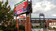 A sign outside the stadium advises that the baseball game between the Philadelphia Phillies and the Washington Nationals has…