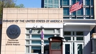 FILE In this file photo taken on Tuesday, May 11, 2021, The U.S. Embassy and the National flag are seen in Moscow, Russia…