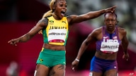 Jamaica's Elaine Thompson-Herah celebrates after winning the women's 100m at the Tokyo Olympics, July 31, 2021.