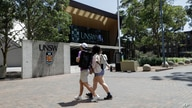 FILE - Students walk on the campus of the University of New South Wales in Sydney, Australia, Dec 1, 2020.