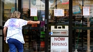A hiring sign is displayed outside a retail store in Buffalo Grove, Illinois, June 24, 2021.