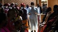 FILE - People wait to receive the AstraZeneca COVID-19 vaccine at Ndirande Health Centre in Blantyre, Malawi, March 29, 2021.