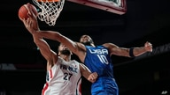 United States' Jayson Tatum (10) is fueled by France's Rudy Gobert (27) during a men's basketball preliminary round game at the 2020 Summer Olympics, July 25, 2021, in Saitama, Japan.