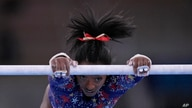 Simone Biles, of United States performs on the uneven bars during the women's artistic gymnastic qualifications at the 2020 Summer Olympics, July 25, 2021, in Tokyo.