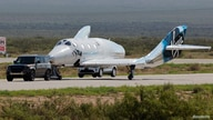 Virgin Galactic's passenger rocket plane VSS Unity is towed to a hangar after reaching the edge of space, at Spaceport America, near Truth or Consequences, New Mexico, July 11, 2021.